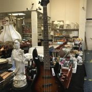 JOHNSON GUITAR WITH STAND - SIGNED PAUL YOUNG