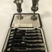 TWO HM SILVER KIDDISH CUPS WITH 6 BOXED SILVER HANDLED CUTLERY