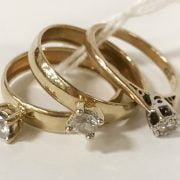 3 9CT GOLD RINGS WITH DIAMONDS