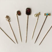 COLLECTION OF GOLD PIN BROOCHES