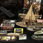COLLECTION OF BOXED MODEL CARS, BATTLE SHIPS & MODEL YACHTS