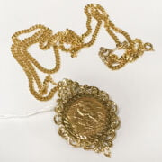1911 HALF SOVEREIGN IN 9CT GOLD MOUNT & 9CT GOLD CHAIN
