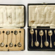 TWO HM SILVER CASED SPOON SETS