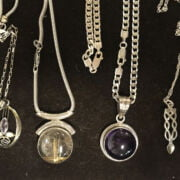 8 SILVER PENDANTS & CHAINS - SOME AMBER & GEMSTONE