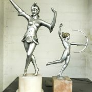 PAIR OF ART DECO FIGURES ON MARBLE BASES TALLEST 32CMS (H)