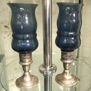 PAIR OF STERLING SILVER & BLUE GLASS STORM LAMPS