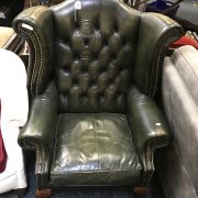 GREEN LEATHER FIRESIDE CHAIR