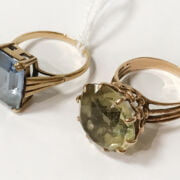9CT GOLD RING WITH EMERALD CUT BLUE TOPAZ & 1 OTHER YELLOW METAL RING