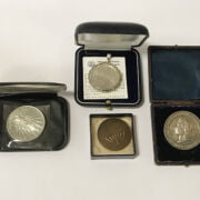 FOUR MEDALS INCLUDING WHITE METAL 1887 QUEEN VICTORIA GOLDEN JUBILEE MEDAL BY HEATON MADE AS BROOCH