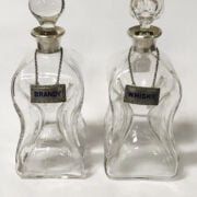 FOUR ASPREY SILVER COLLAR DECANTERS WITH SILVER DRINK LABEL