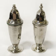 TWO SILVER SALT & PEPPER POTS WITH SILVER MEDAL, SUGAR TONGS & SPOONS ALONG...