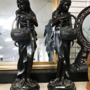 TWO BRONZE NUDE FIGURES HOLDING BASKETS OF FLOWERS - EACH 86CMS