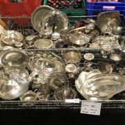 TWO TRAYS OF SILVER PLATE / METALWARE