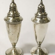 TWO SILVER SALT & PEPPER POTS WITH A SILVER MUSTARD DISH & SILVER SPOON