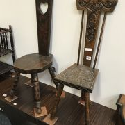 2 CARVED MILKING STOOLS
