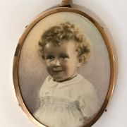 EARLY SIGNED RETOUCHED PHOTO OF A CHILD IN LEATHER DISPLAY CASE WITH GOLD P...