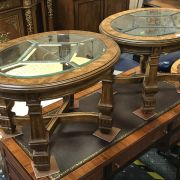 PAIR OF OVAL WALNUT GLASS TOP TABLES